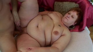Red head fatty gets fucked by a young russian guy